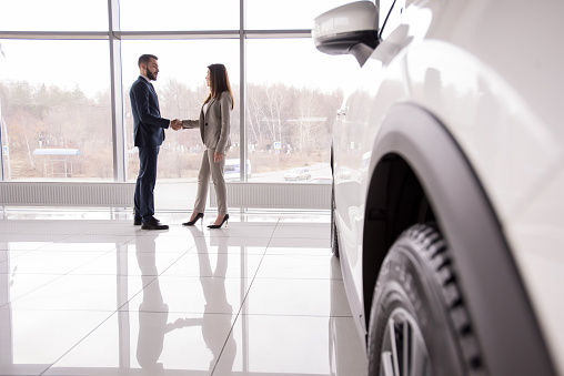Car Salesman Shaking Hands With Customer Stock Photo - Download Image Now