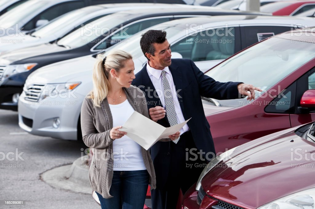 Car salesman with a customer royalty-free stock photo