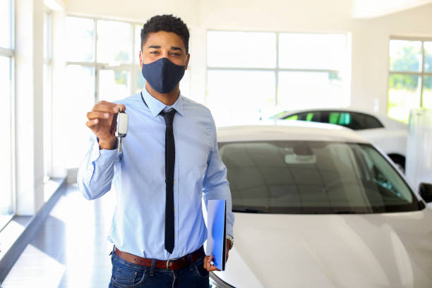 Car salesman working during the pandemic stock photo