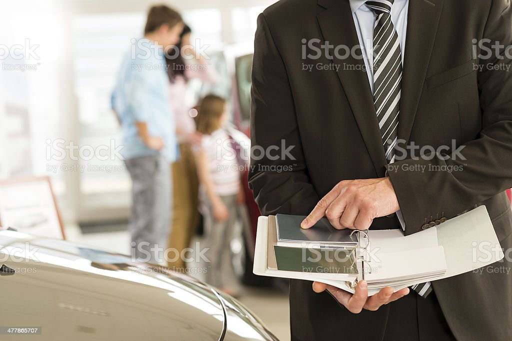 Car salesman's hands holding color swatches royalty-free stock photo
