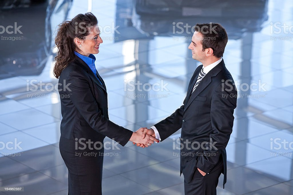 Car salesperson, buyer and agreement royalty-free stock photo