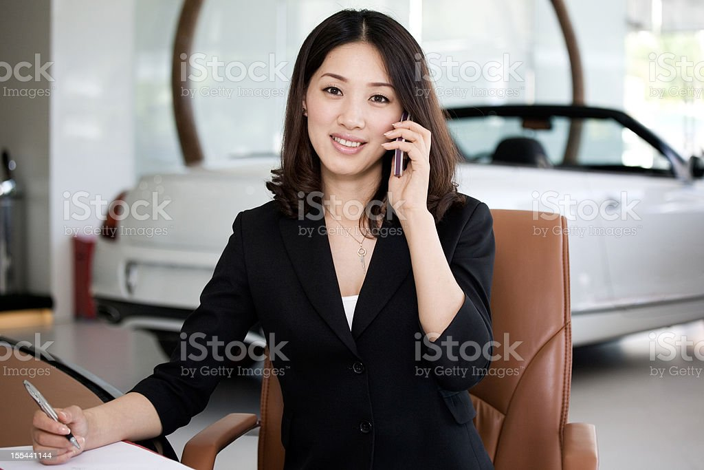 Car Salesperson on cell phone royalty-free stock photo