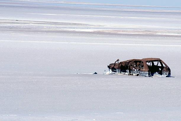Car scrap on the beach stock photo