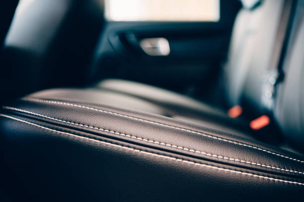 car seat leather upholstery detail - car interior stock photos and pictures