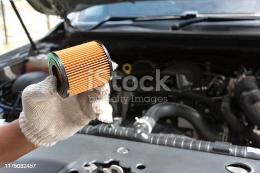 1073743202 istock photo Car servicing, replacing of motor oil or fuel filter of car in the engine room 1175032457