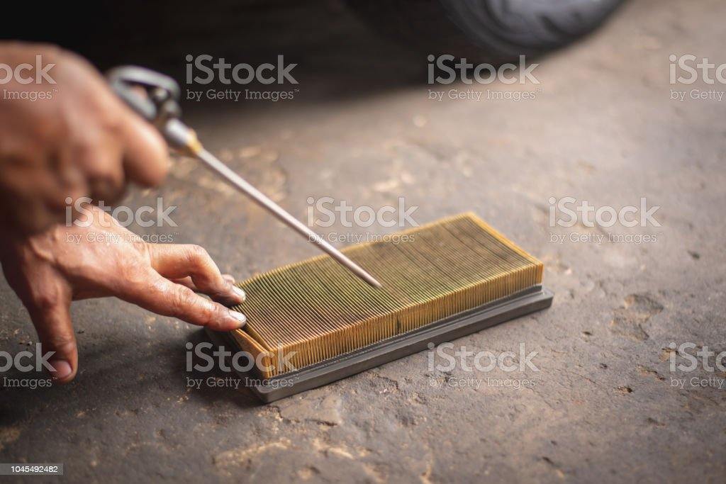 Car servicing, replacing of paper air filter stock photo