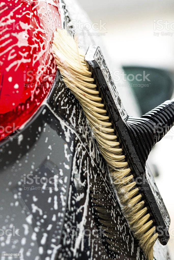 Car shampoo and scrub brush stock photo