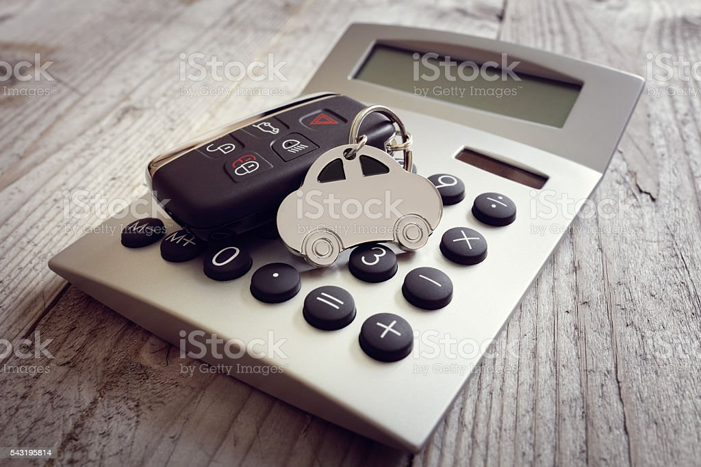 Car shape keyring and key on calculator stock photo