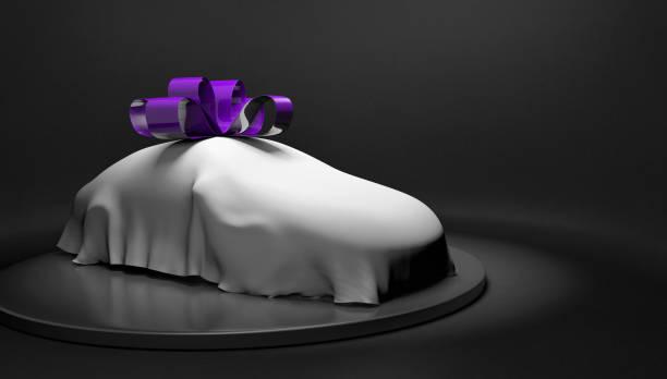 auto show-konzept eines neuwagens gewickelt mit einem deckel und bogen zu enthüllt werden, 3d-rendering - autoschleifen stock-fotos und bilder