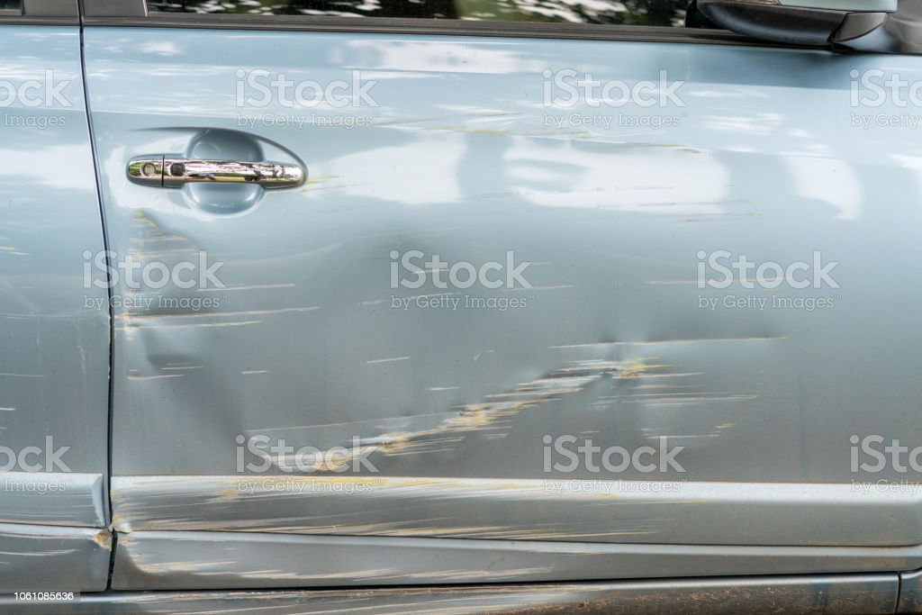 Car Side Is Scratched And Scraped With Deep Damage To The