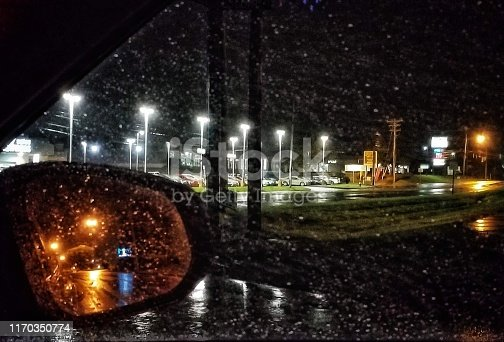 This a 2-for-1 special photo. Side mirror reflection of street lights, plus side window view of street & parking lot lights. All with those beautiful raindrops decorating my view. Then there's the puddle at the bottom of the shot. And I think I caught a billboard or some sort of blurred image in my mirror which I hadn't noticed before. This photo excites me and I hope it does the same for you!