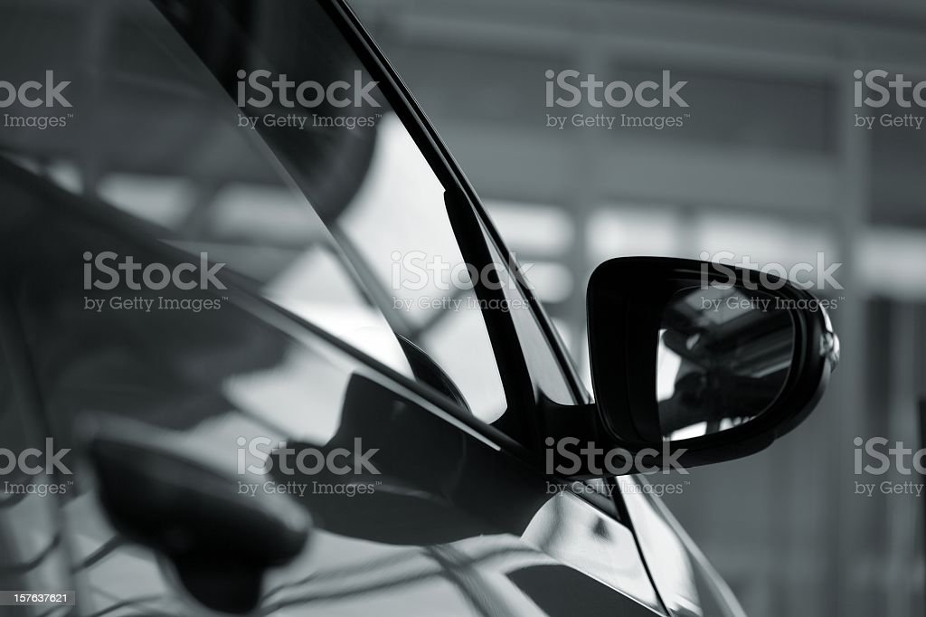 car side mirror (side view of a new  car) royalty-free stock photo