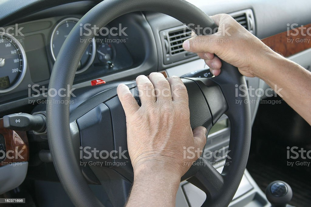 \'Close up of the male hand, pressing on car signal on rudder\'