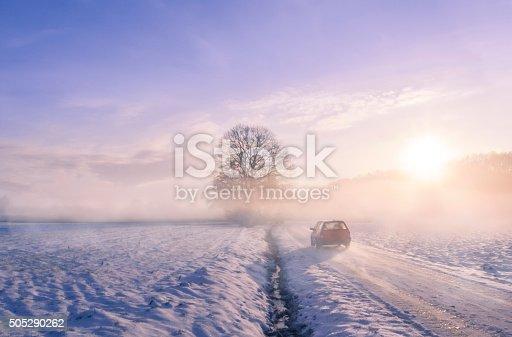 657042754 istock photo Car silhouette through fog on a winter morning 505290262