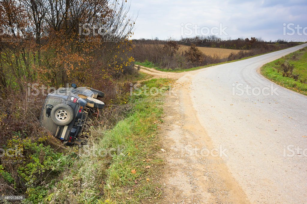 Car skidded off the road and crashed into ditch stock photo