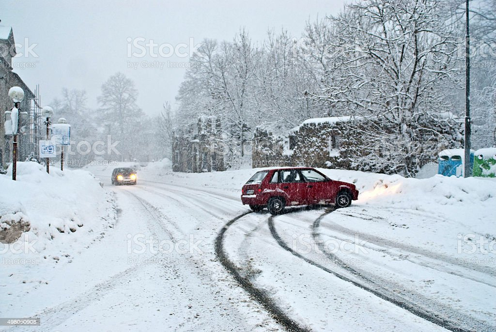 car slide out of snow road stock photo