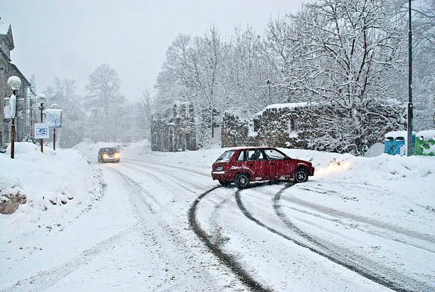 car slide out of snow road - sliding stock photos and pictures