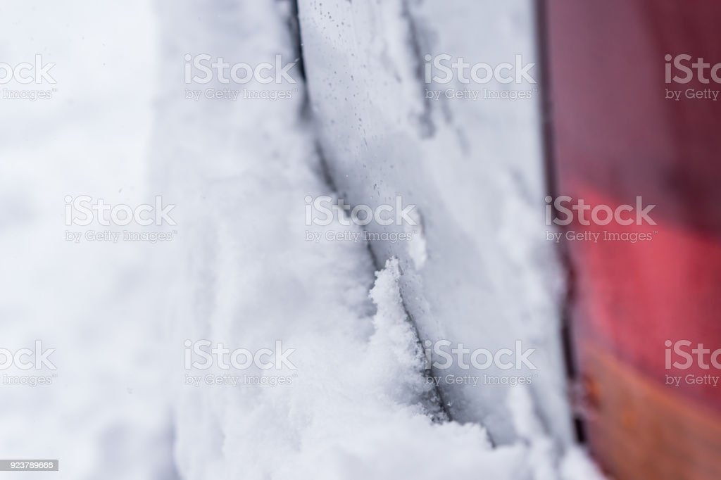 Car snow-covered, back of a snow-covered car. Close-up of a rural yard covered with a snow. Extreme winter series. stock photo