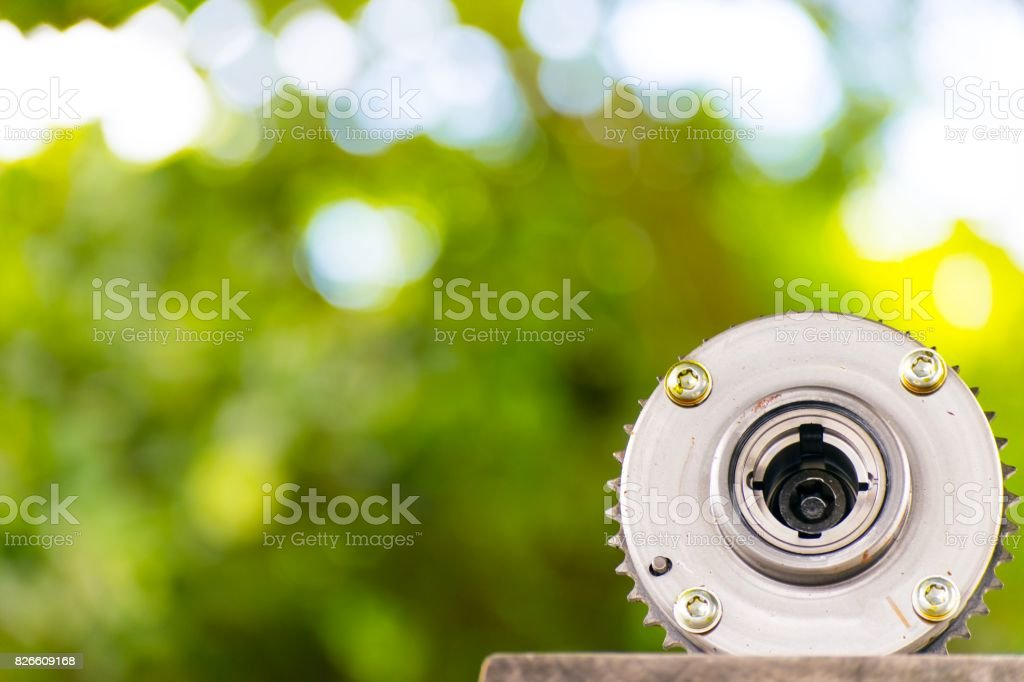 Car spare parts on tree blurry bokeh background. using wallpaper or background for Automobile industry with  car factory  and product package image. stock photo