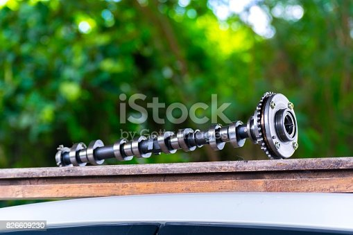 istock Car spare parts on tree blurry bokeh background. using wallpaper or background for Automobile industry with  car factory  and product package image. 826609230