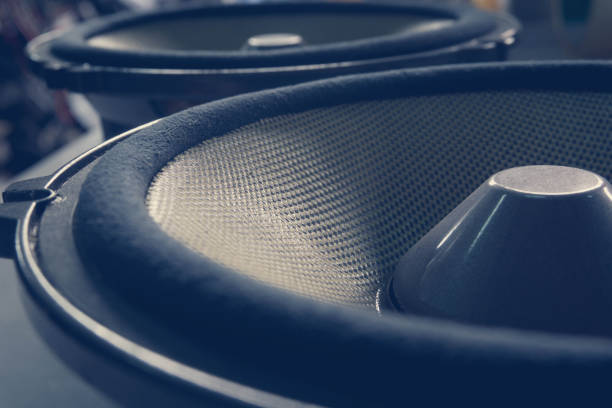 Car speaker audio Part of yellow old car audio speaker, vintage filtered effect stereo stock pictures, royalty-free photos & images