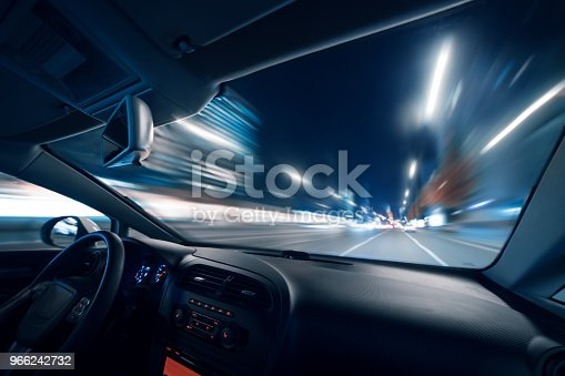 Car speed drive on the road in night city