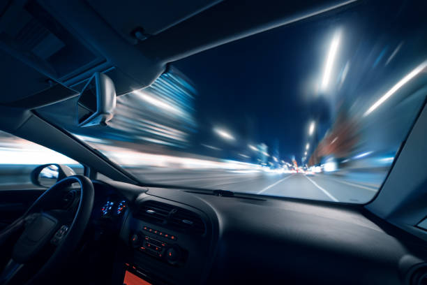 Car speed drive on the road in night city stock photo