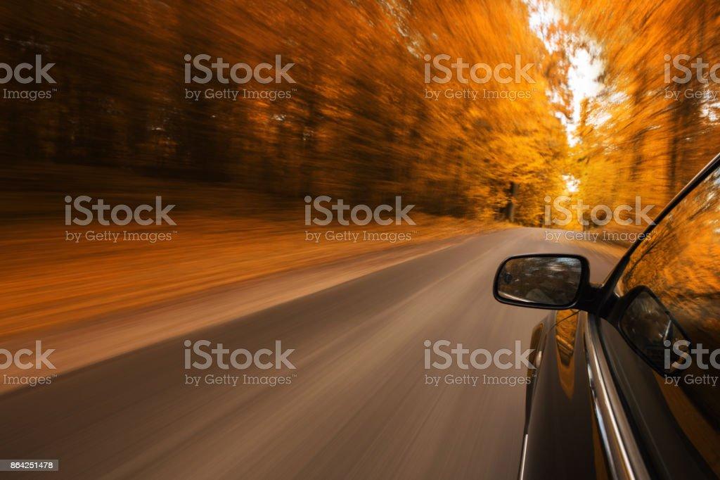 Car speeding on the road royalty-free stock photo