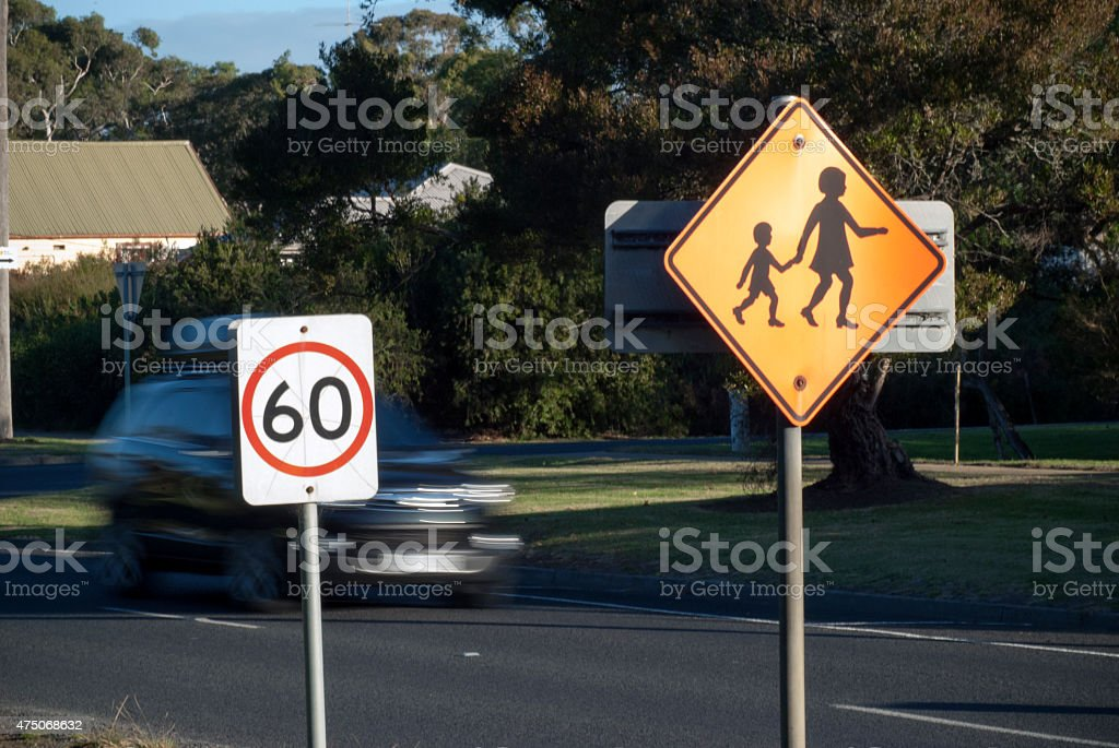 car speeding past speed limit sign stock photo