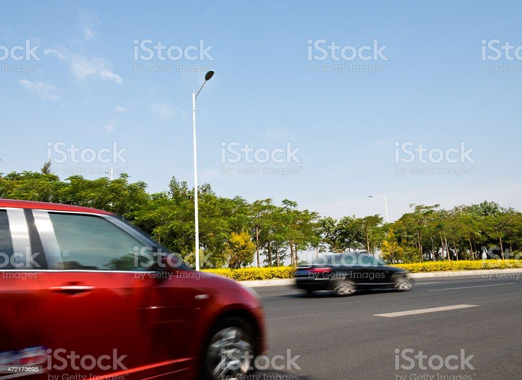 car speeding stock photo