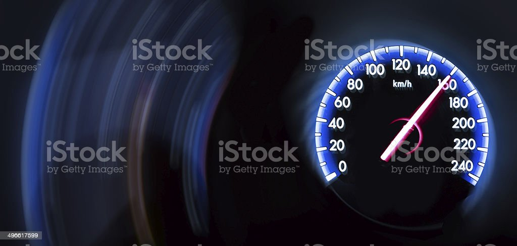 Car Speedometer on dark background royalty-free stock photo