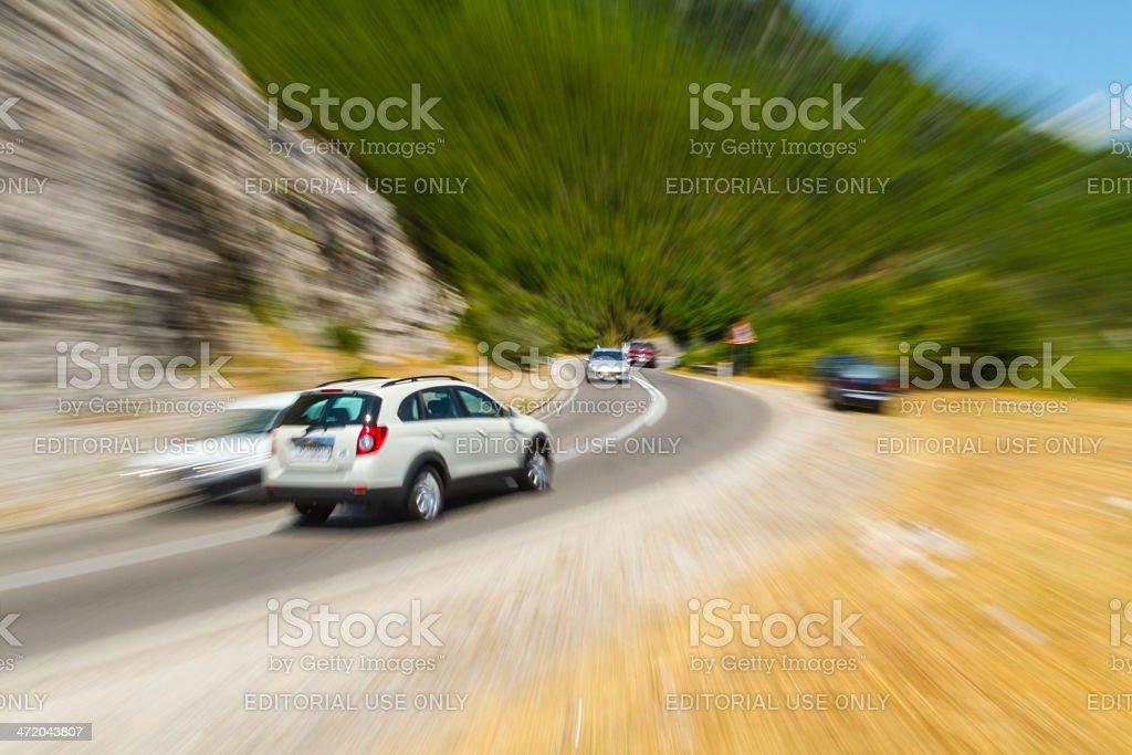 Car speeds through on the Montenegro interurban road royalty-free stock photo