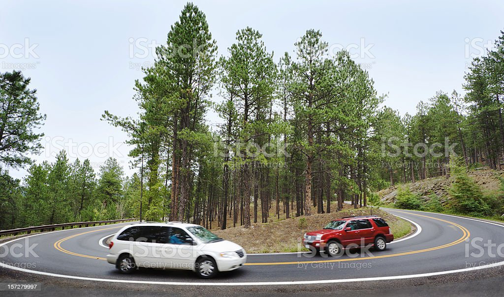 Car, Sports Utility Vehicle Driving Around Mountain Road Hairpin Curve royalty-free stock photo
