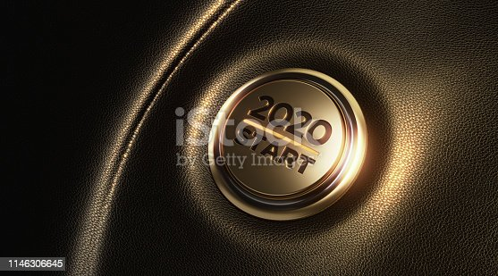 Car start button on dashboard. 2020 writes on push button. Horizontal composition with copy space and selective focus. New year concept.