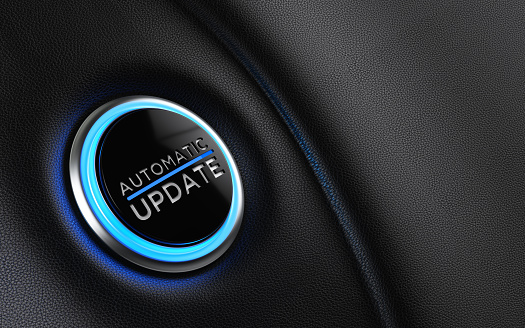 Car start button on dashboard. Automatic update writes on push button. Horizontal composition with copy space and selective focus.