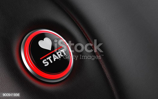 Car start button on dashboard. There is a heart shape on push button. Horizontal composition with copy space and selective focus. Valentine's Day concept.