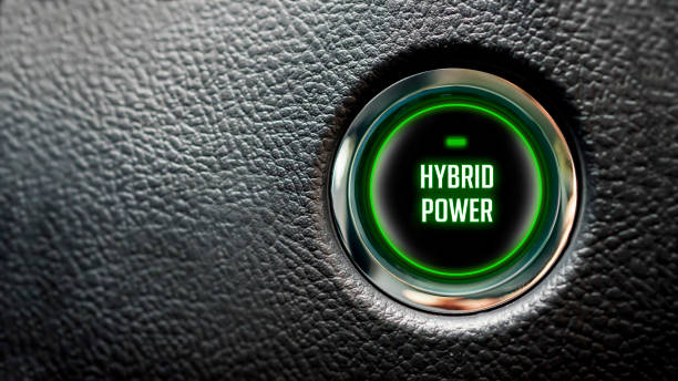 Car Start Button On Dashboard with hybrid power message stock photo