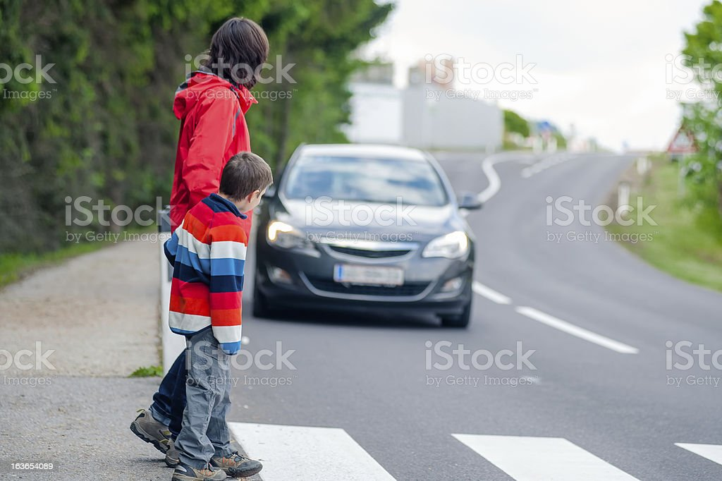 Car stopped for pedestrian stock photo