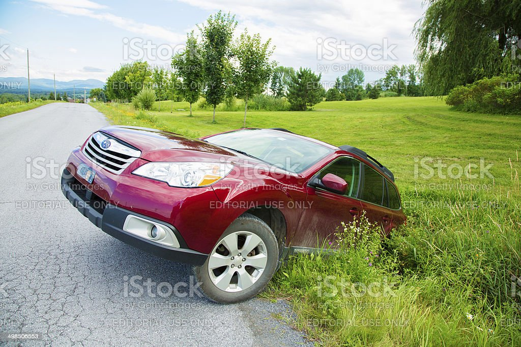 Car stuck in a deep road ditch stock photo