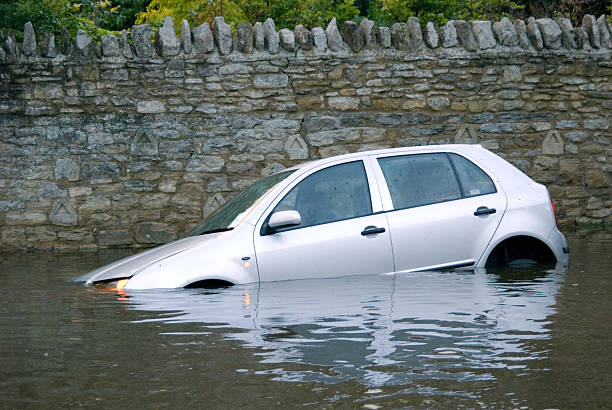 Car stuck in Rural flooding stock photo