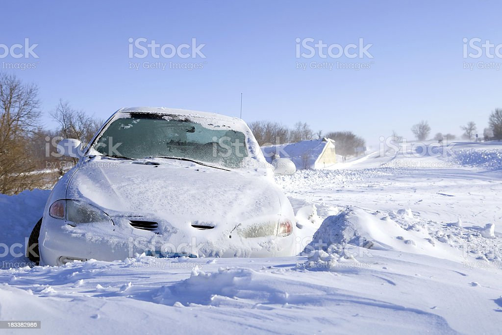 Car Stuck in Snow off an Interstate Highway royalty-free stock photo