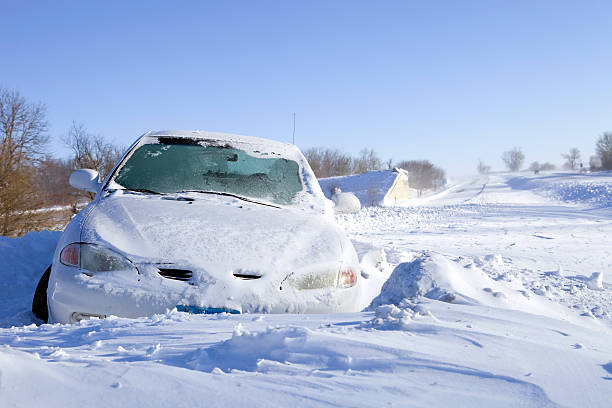 Car Stuck in Snow off an Interstate Highway stock photo