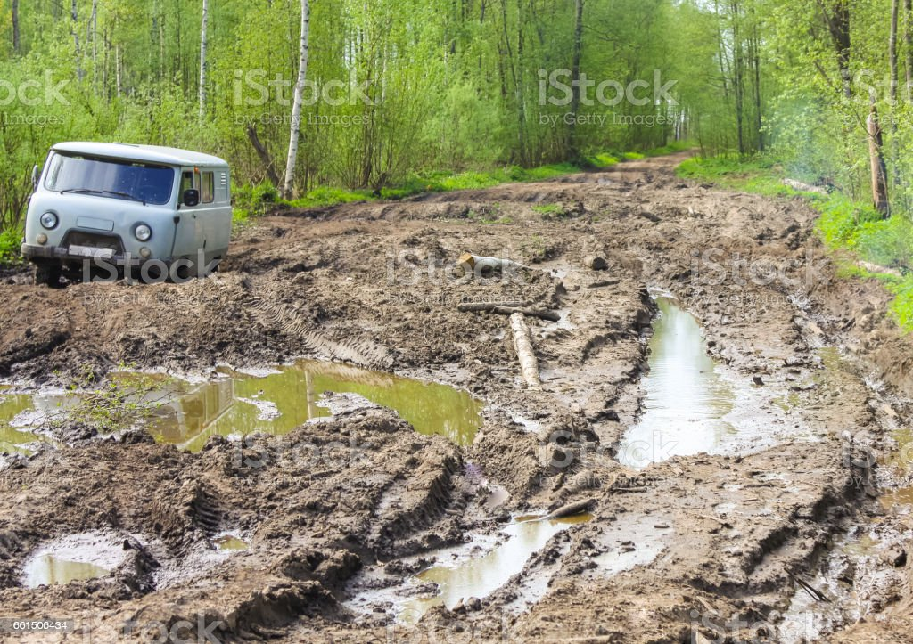 Car stuck in the muddy forest road stock photo