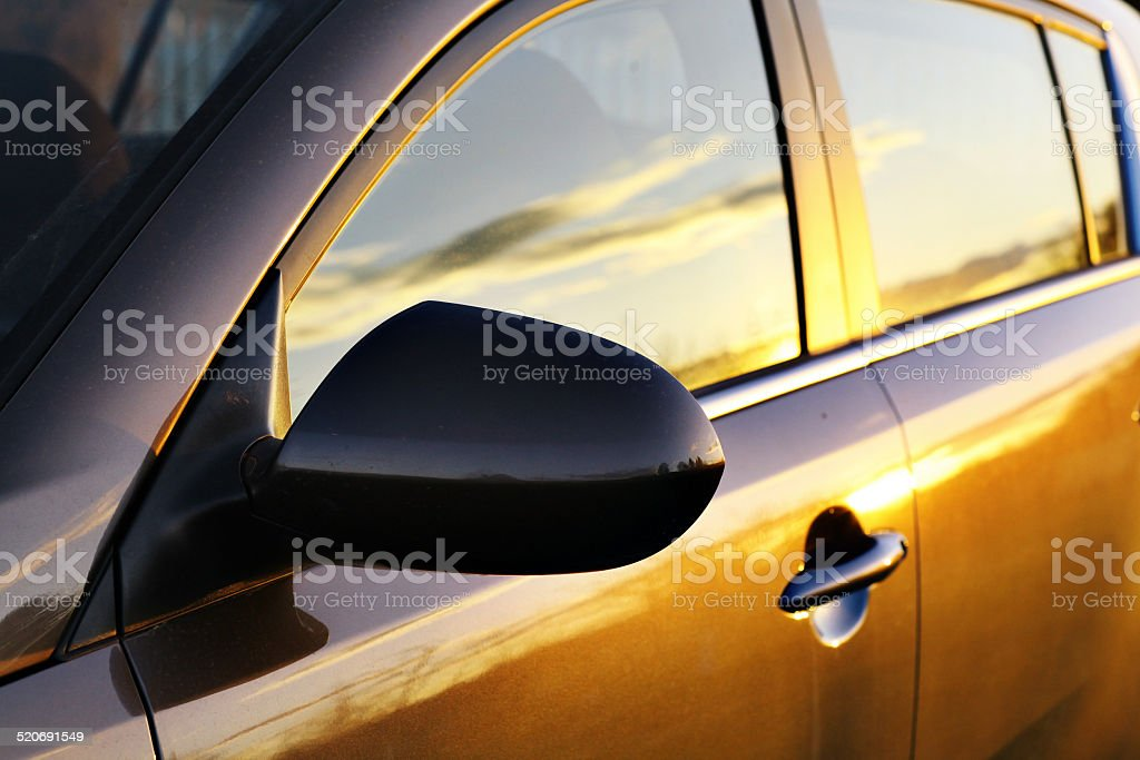 car sunset reflection stock photo