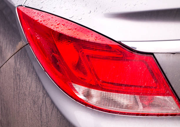Car Taillight in Raindrops and Dirt stock photo