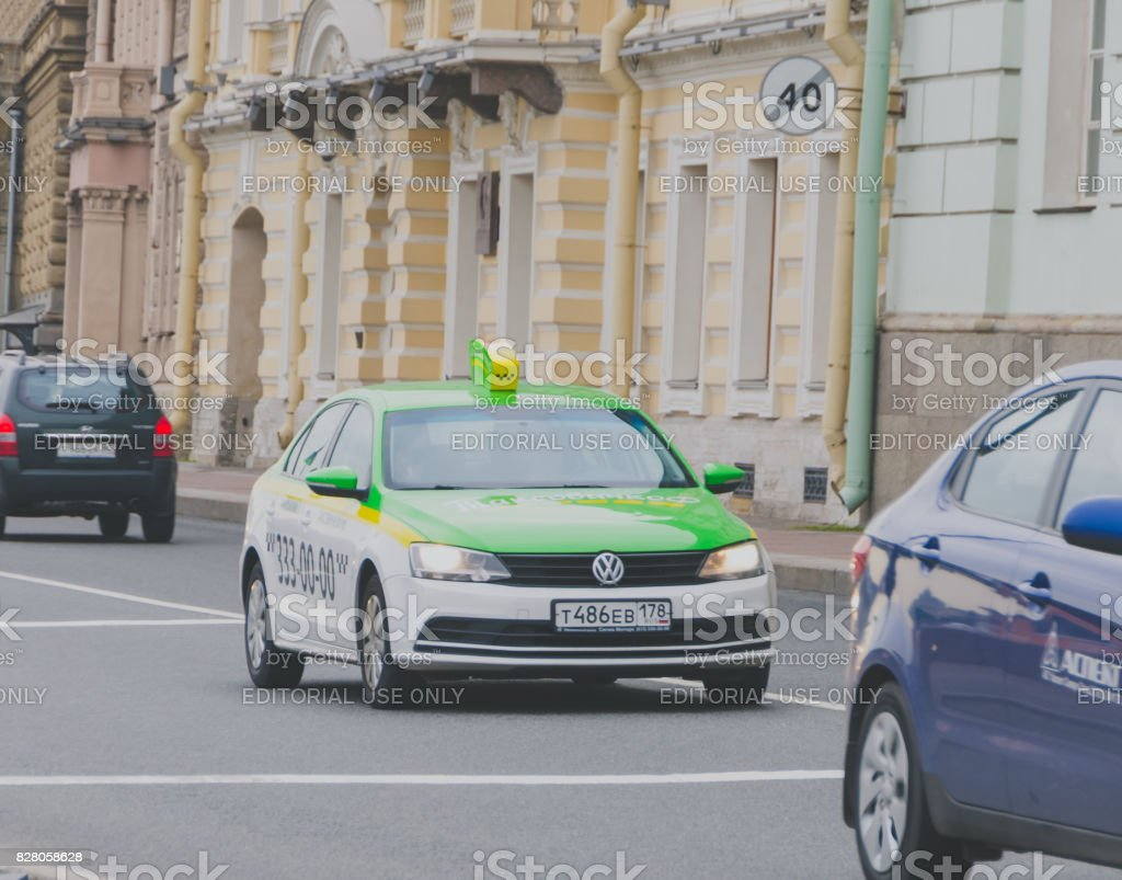 car taxi green on the road stock photo