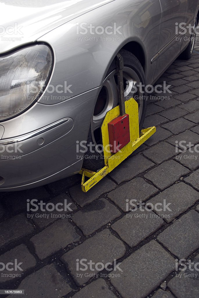 Car that has been wheel clamped stock photo