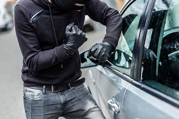 Car thief, car theft stock photo