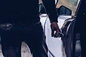 istock Car thief opening stolen car doors 1129129278