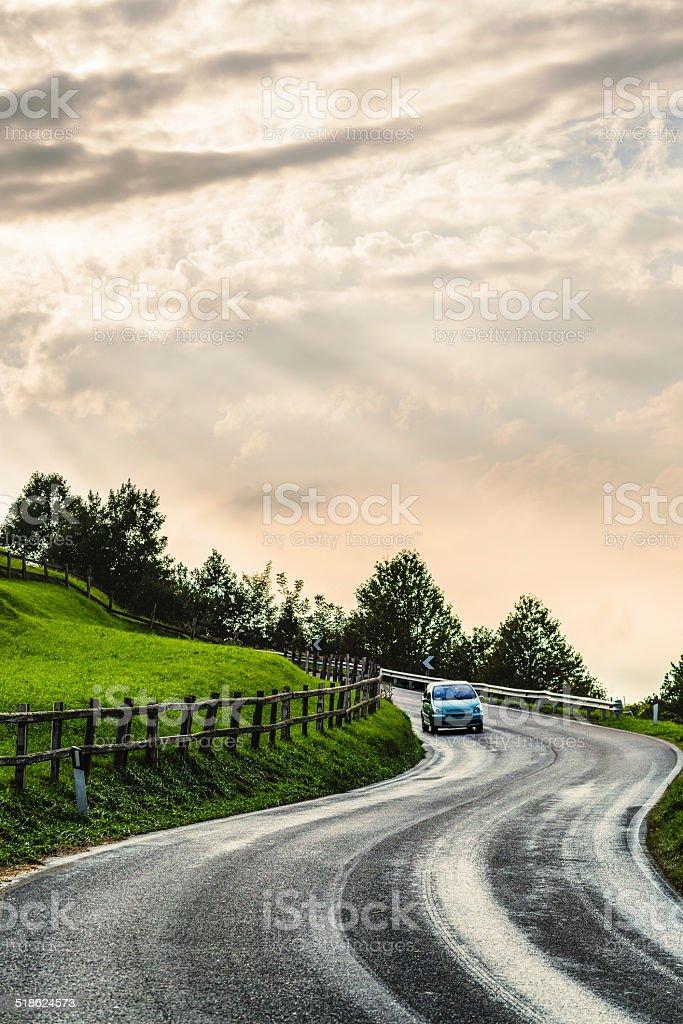 Car through a country road stock photo